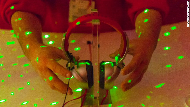 Disco lights flash at Sony's music lounge, showing off its X05 headphones, during Monday's press day.