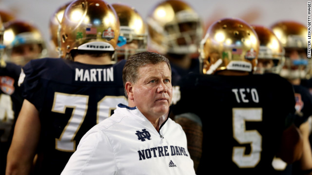 Notre Dame head coach Jim Kelly watches the game from the sidelines.