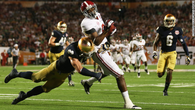 Zeke Motta of Notre Dame tackles Alabama's Amari Cooper.