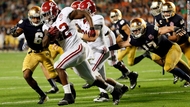 Alabama running back Eddie Lacy carries the ball against Notre Dame.