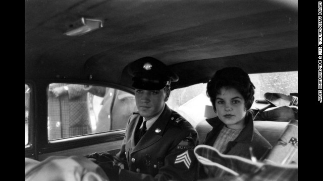 Elvis Presley's musical heyday was in the 1950s, but he remained a major star in the 1960s. Here, Presley, 25, is pictured with his future wife, Priscilla, shortly before his discharge from the U.S. Army in 1960. Presley served two years in the Army.