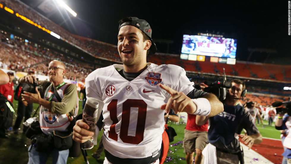 Quarterback AJ McCarron of the Alabama Crimson Tide celebrates his team's win over the Notre Dame Fighting Irish on Monday, January 7. Alabama defeated Notre Dame 42-14 in the 2013 BCS National Championship game at Sun Life Stadium in Miami Gardens, Florida. <a href='http://www.cnn.com/2012/12/31/football/gallery/college-bowls/index.html'>View the best photos from the college football bowl games.</a>