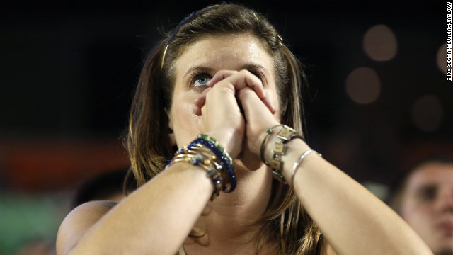 A Notre Dame fan watches the second half of the game against Alabama.