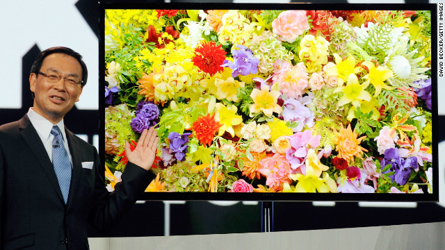 CEO Kazuhiro Tsuga unveils Panasonic's new 4K OLED televison Tuesday at CES. 