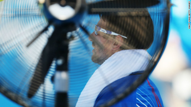 Tommy Robredo of Spain rests next to a fan in between games in his first round match against John Millman of Australia during day three of Sydney International at Sydney Olympic Park Tennis Centre.
