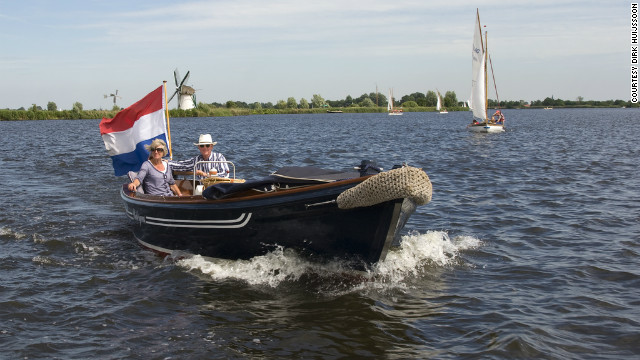 A couple set sail on Lake Kaag, the Netherlands. Boat races and regattas are a common site here in the summer months.