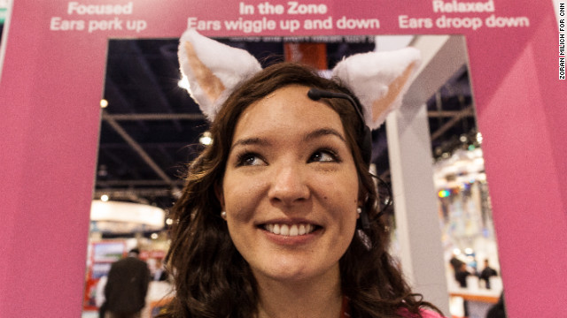 A woman demonstrates Necomimi Brainwave cat ears Wednesday. According to the company, the ears read your brain waves to determine your mood and reflect it by wiggling, perking up or drooping down.