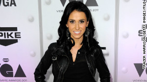 Jenn Sterger, shown here at Spike TV\'s \'2011 Video Game Awards\' in Los Angeles, stepped into the limelight when Musburger alluded to her beauty when ABC showed her at a 2005 football game.