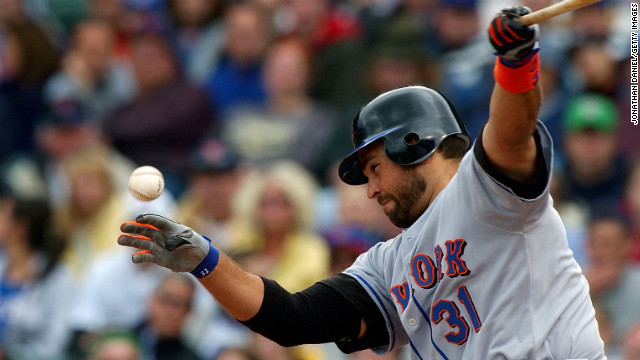 New York Mets catcher Mike Piazza takes a swing during a game against the Chicago Cubs on April 25, 2004, at Wrigley Field in Chicago.
