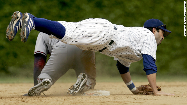 Todd Walker of the Chicago Cubs flips over a Washington Nationals player after throwing the ball on a double play during a game in Chicago on May 18, 2006.