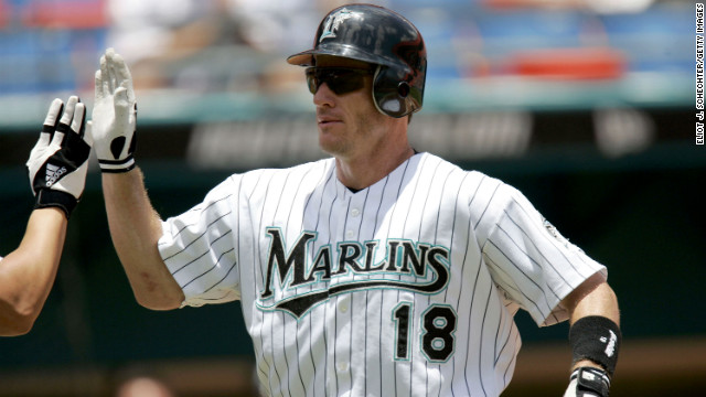 Left fielder Jeff Conine of the Florida Marlins celebrates a home run against the Philadelphia Phillies in Miami on July 29, 2004.