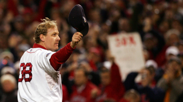 Curt Schilling of the Boston Red Sox tips his hat to the crowd as he leaves the game in the sixth inning against the Colorado Rockies during Game Two of the 2007 World Series at Fenway Park on October 25, 2007, in Boston.