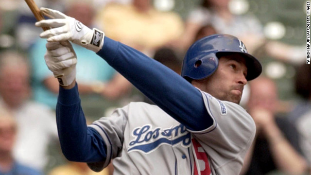 Los Angeles Dodgers outfielder Shawn Green hits his fourth home run of the day against the Milwaukee Brewers on May 23, 2002, in Milwaukee, Wisconsin.