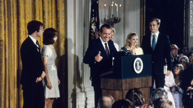 Surrounded by family members, Nixon delivers his resignation speech on August 9, 1974. He stepped down after the Watergate scandal, which stemmed from a break-in at the Democratic National Committee offices during the 1972 campaign.