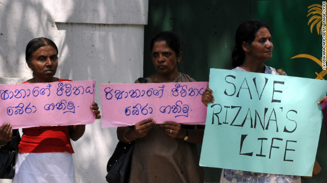 (File photo) Sri Lankan women hold a placard in protest, outside the Saudi Arabia embassy in Colombo on November 9, 2010.