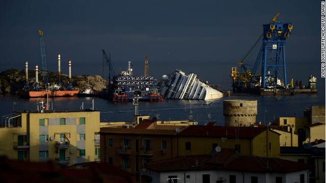 On January 13, 2012, the cruise ship Costa Concordia crashed into a bed of rocks near the port on the Italian island of Giglio, taking 32 lives. Although the ship owner announced that efforts to move the cruise liner would begin in May, the ship carcass still lies halfway submerged a year later.