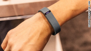 The Fitbit Flex costs $99 and tracks your steps, distance traveled, calories burned and sleep.