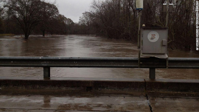 A flood gauge keeps track of rising waters Thursday in Louisiana.