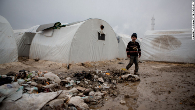 A Syrian boy walks near rubbish next to tents at a refugee camp near the northern city of Azaz on the Syria-Turkey border, on January 8.