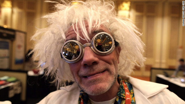 An exhibitor dressed as Doc Brown from the &quot;Back to the Future&quot; movies greets people at the Securifi booth at the Consumers Electronic Show in Las Vegas. The annual event is the largest gadget conference in the world. Check out photographer Zoran Milich's take on the action.
