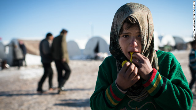 A boy plays with a balloon in a Syrian refugees camp in Azaz, near the Turkish border, on January 10.