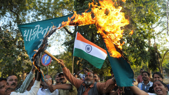 Indian demonstrators burn a banner which reads 'Down with Pakistan, Shame on Pakistan' in Ahmedabad on January 10, 2013.