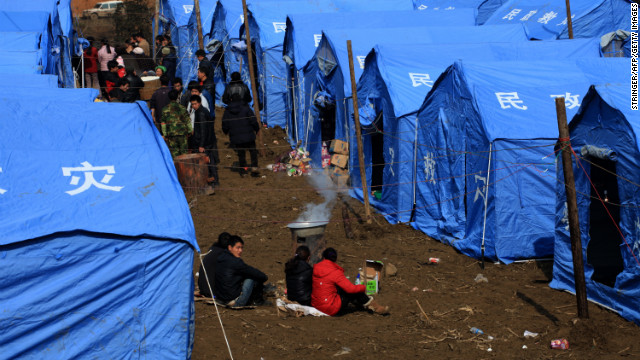 Displaced residents gather near temporary tents on Saturday, January 12, after the rescue mission is finished.