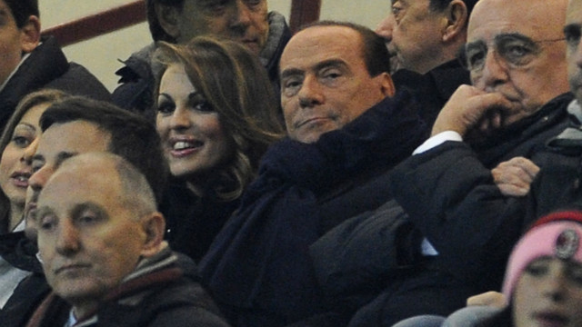 &quot;Berlusconi is an opportunist, who will say anything to win short-term support,&quot; Italian historian John Foot -- the author of the authoritative book on Italian football &quot;Calcio&quot; -- told CNN, in reference to the AC Milan owner's support for Boateng after the player walked off the pitch. &quot;His comments are hypocritical at best, especially given his alliance with anti-immigrant and far-right parties, and his comments on Barack Obama (he called him 'sun-tanned'),&quot; added Foot. Berlusconi is pictured in the center, wearing a scarf.