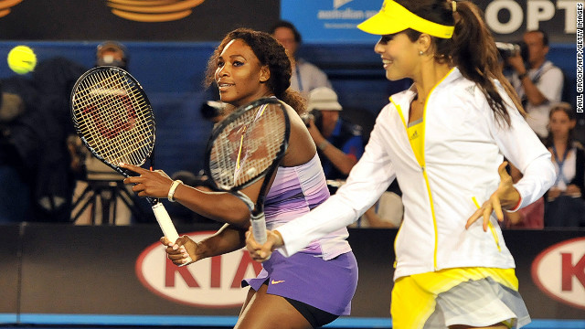 Brisbane title winner Serena Williams (L) watches a volley by Ana Ivanovic of Serbia (R) as they take part in a Kids Day exhibition match in Melbourne on January 12.