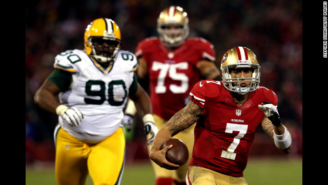 Quarterback Colin Kaepernick of the 49ers runs the ball against nose tackle B.J. Raji of the Packers on Saturday.