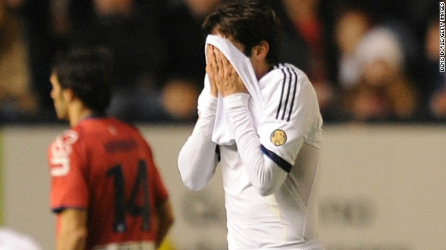 Kaka hides his face after being shown the red card during Real Madrid's 0-0 draw in Pamplona on January 12.