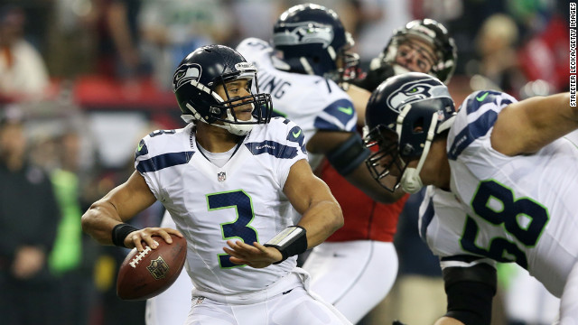 Seahawks quarterback Russell Wilson looks to pass against the Falcons in the first quarter on Sunday.