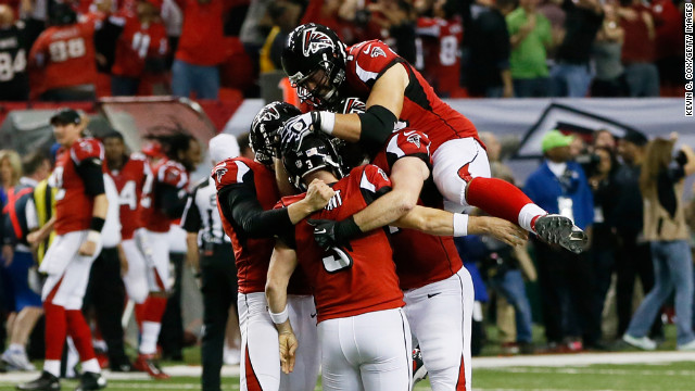 The Falcons celebrate their 30 to 28 win over the Seahawks on Sunday.