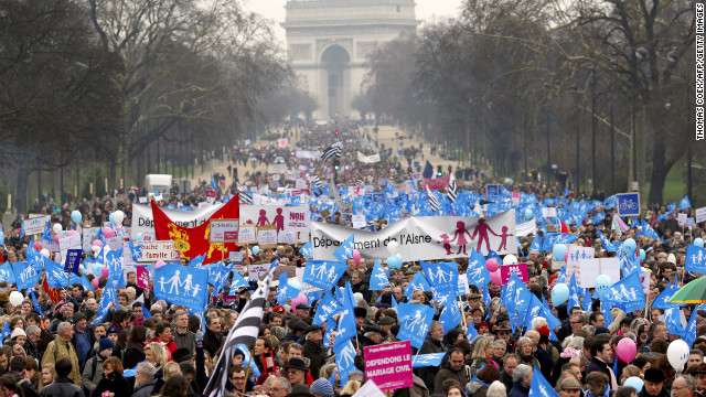 Tens of thousands march in Paris on January 13 to denounce government plans to legalize same-sex marriage and adoption.