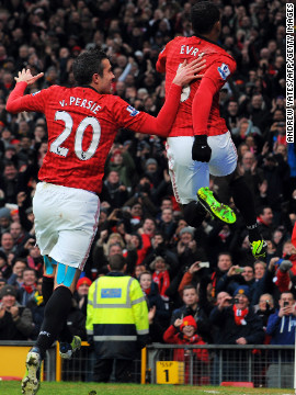 Evra, right, celebrates the goal with United's top scorer Robin van Persie at Old Trafford, as Alex Ferguson's team retained a seven-point lead in the English Premier League.