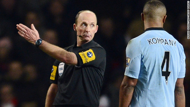 City also went down to 10 men in the second half when captain Vincent Kompany (R) was shown a red card by referee Mike Dean for his sliding tackle on Arsenal midfielder Jack Wilshere.