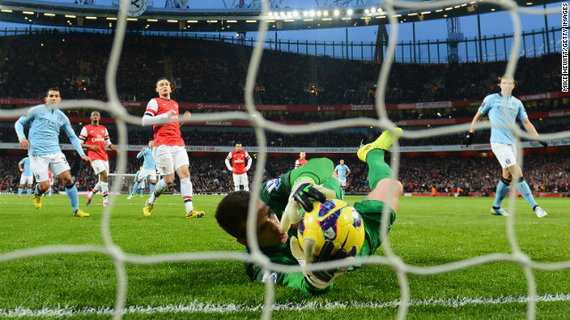 Dzeko's penalty was saved by Wojciech Szczesny, who gratefully grabbed the ball after it hit his legs and rebounded off the post. 