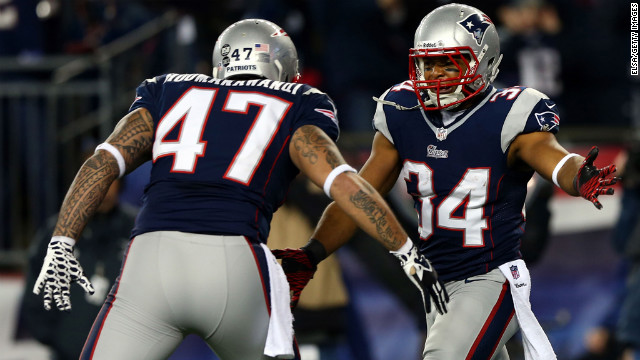 Shane Vereen of the Patriots celebrates with teammate Michael Hoomanawanui after scoring a touchdown in the first quarter against the Texans on Sunday.