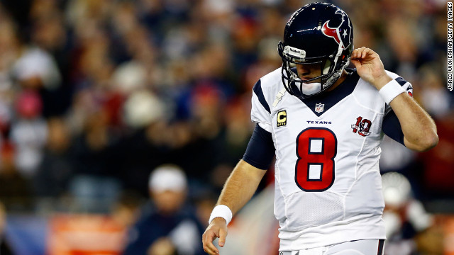 Matt Schaub of the Texans walks off the field after failing to convert on third down against the Patriots on Sunday.
