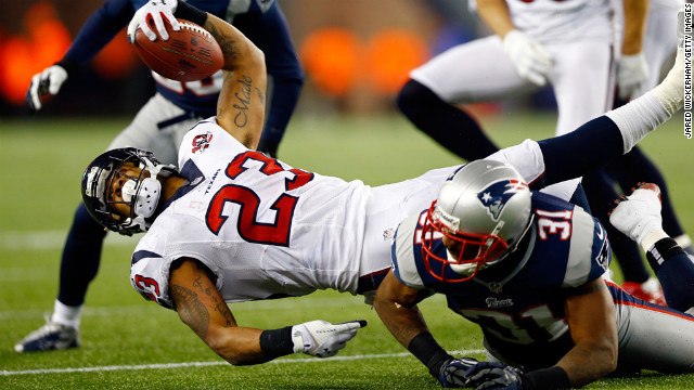 Arian Foster of the Houston Texans stretches for a first down against the Patriots on Sunday.