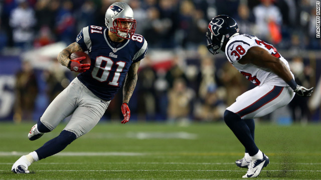 Aaron Hernandez of the New England Patriots runs the ball against Danieal Manning of the Houston Texans.