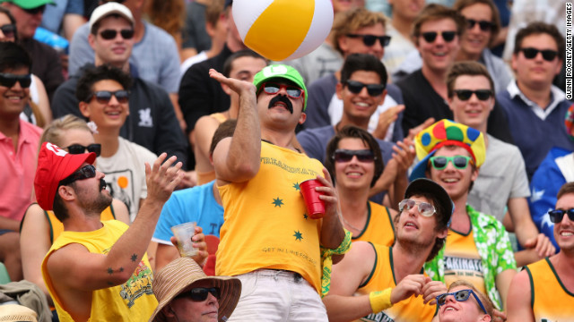 Australian tennis fans enjoy the atmosphere during the women's first-round match on January 14 between Sesil Karatantcheva of Poland and Na Li of China. Li won 6-1 6-3.