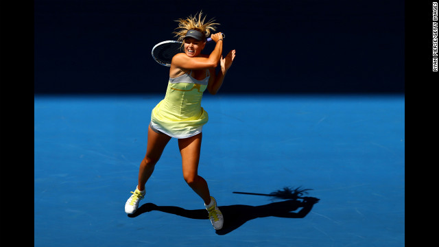 Russia's Maria Sharapova plays a backhand in her first-round match against Russia's Olga Puchkova on the first day of the Australian Open. 
