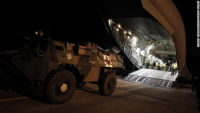 A French armored vehicle rolls onto a British army aircraft to be taken to Bamako on Sunday in Evreux.