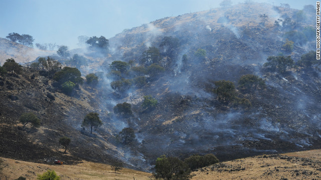 A scrub fire burns up a hillside south of Bookham near Yass on Friday.