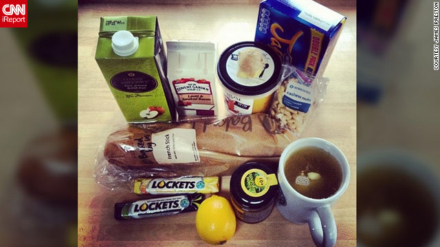 "James Preston of Chewton Mendip, England, is hunkering down as he battles what he calls the worst stage of his ""man-flu."" His flu survival kit consists of a variety of home remedies, medicine and snacks, such as apple juice, cough drops and French bread for his soup."