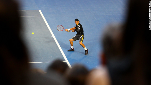 Lleyton Hewitt of Australia plays a backhand in his first-round match against Janko Tipsarevic of Serbia on January 14. Hewitt lost 7-6(4) 7-5 6-3.