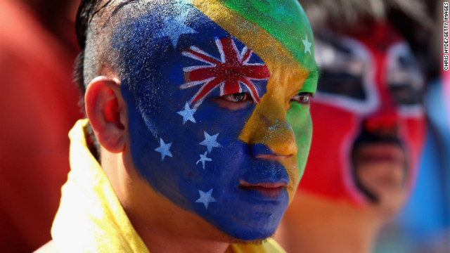 A saturated spectator watches the action on Day 1 of the Australian Open.