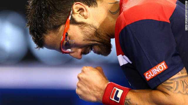 Janko Tipsarevic of Serbia celebrates winning a point in his first-round match against Lleyton Hewitt of Australia on January 14. Tipsarevic won 7-6(4) 7-5 6-3.