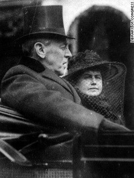 President Woodrow Wilson rides by carriage with wife Edith to his second inauguration on March 5, 1917.